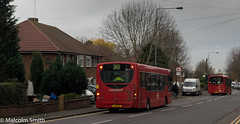 Down The Hill Together (M C Smith) Tags: bus buses red route 313 379 letters numbers symbols busstop walls traffic road kerb pavement houses van white black green trees hedges bins waste recycling cardboard gardens waiting standing walking people passengers hivi yellow lines lampposts gate reflections sky