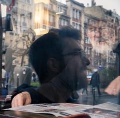 From past to present - a breath (mamat75019) Tags: fuji 35mm 35mmf2 past present passé mirror reflection reflet regard restaurant street photography paris parisiens life vie breath souffle café journal newspaper coffee