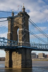 Tower of the Roebling Suspension Bridge (durand clark) Tags: roeblingbridge roeblingsuspensionbridge suspensionbridge river ohioriver tower cincinnati covington ohio kentucky suspensiontower nikond750 clouds water