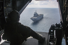A U.S. Marine observes the French navy amphibious assault ship BPC Dixmude (L9015) in the Atlantic Ocean, Jan. 6, 2020. (Official U.S. Navy Imagery) Tags: usmarines usmc spmagtfcraf201 mv22ospreys ace frenchnavy dixmude atlanticocean touchngo ambi 2020 frenchamphibiousassaultship frenchnavalforces partnerships