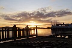 Sunrise, HFF (evisdotter) Tags: sunrise morning light hff fence boat sun sunny sky clouds reflections landscape mariehamn österhamn