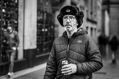 Meanwhile, in Soviet Glasgow... (Leanne Boulton) Tags: urban street candid portrait portraiture streetphotography candidstreetphotography candidportrait streetportrait streetlife man male face eyes expression mood emotion feeling glasses hat juxtaposition soviet russia insignia pin tone texture detail depthoffield bokeh naturallight outdoor light shade city scene human life living humanity society culture lifestyle people canon canon5dmkiii 50mm primelens ef50mmf14usm black white blackwhite bw mono blackandwhite monochrome glasgow scotland uk
