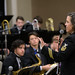 Navy musician works with students from Hoover High School in Hoover, Ala. during the 11th annual Jazz Education Network Conference in New Orleans.