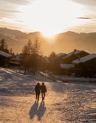WAlking couple towards the sun
