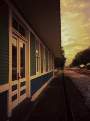 last train gone..... (farrargirl1) Tags: doorsandwindows smalltownamerica florida defuniaksprings railroadtracks sunset traindepot trainstation