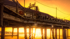Southwold Underglow (Aron Radford Photography) Tags: blue southwold suffolk pier beach coast sea sand sunrise dawn sun flare east anglia landscape seascape wodden structure glow under