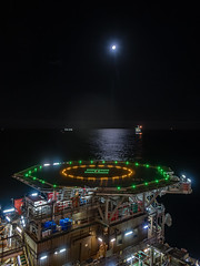 "Night Time Offshore (Craig Hannah) Tags: ""wolfmoon"" nightsky nightphotography offshore oilrig oil gas helideck lights moon moonlight northsea scotland craighannah canon platform industry industrial structure outdoors atnight tranquil atsea g7mk2"