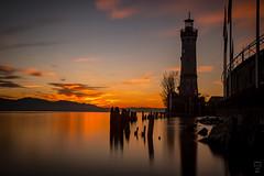 Sundown Lindau Harbour (Meinolle) Tags: sundown lindau winter longexposure longer water harbour port bodensee lake lakeconstanze bavaria bayern deutschland germany lighthouse löwe sky clouds light canon5dmkiii