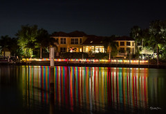 Light On Water (SteveFrazierPhotography.com) Tags: puntagorda isles southwest southwestern fl florida charlottecounty boat water dock pier stevefrazierphotography canoneos60d dark night stars home trees lit colors colorful le lighttrails tropical reflections beautiful christmas 2013 photographer walls