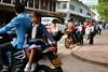 Laotian schoolgirl on motorbike