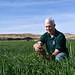 District Conservationist - Lynn Larsen with soil