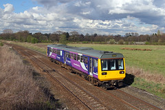 142060 Mobberley 10th April 2012 (John Eyres) Tags: 142060 seen passing mobberley with man picc chester service 100412
