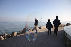 Bubble (velenux) Tags: pesaro mare sea bolledisapone soap bubbles street streetphotography thedecisivemoment