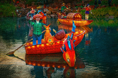 Fishing Boats (jta1950) Tags: water reflections statue figurine texture montrealbotanicalgardens gardenoflight evening night lights