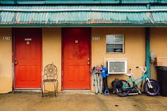 Consecutive Urbanites (The Really Bad Photographer) Tags: apartment building doors bicycle chairs window benton arkansas 2020 usa nikon z7 nef raw lr urban south southern