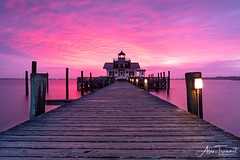 First Blush-Roanoke Marshes Lighthouse (Manteo, North Carolina) (Alan Trammel Photography) Tags: manteo outerbanks roanokeisland lighthouse sunrise scenic obx shallowbagbay northcarolina nc ocean coast coastal landscapephotography eastcoast nikon d750 pink dramaticsky sky colorful carolinas outdoor 20mm leading lines dock pier lighthouses east dawn alan trammel atlantic beach eastern waterfront harbour boardwalk photography