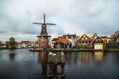 Molen de Adriaan is a windmill in the Netherlands that burnt down in 1932 and was rebuilt in 2002. The original windmill dates from 1779 and the mill has been a distinctive part of the skyline of Haarlem for centuries. (elena.kazantzanidou) Tags: haarlem netherlands canal windmill buildings water bird rainyday cloudysky