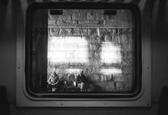 Happiness TV (Ash and Debris) Tags: guy television people blackandwhite blacknwhite light platform bw waiting seat grey kiev train gray glass bnw window street streetshot city tv depression ukraine mood streetmoment monochrome oldwoman look woman depresses bricks kyiv wall man station urban