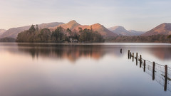 Dawn Reflections (Pete Rowbottom, Wigan, UK) Tags: derwentwater lake peterowbottom mountains thelakedistrict cumbria uk england nikon still calm peaceful serene derwentisle dawn sunrise longexposurelandscape fence waterreflections greatbritain keswick nisi pastel snow lonehouse