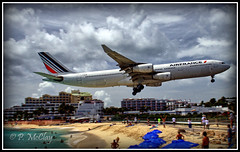 Another Day at the Beach (pandt) Tags: airfrance airplane beach stmaarten airport landing caribbean umbrella mahobeach mahobay ocean people hotels sky sand clouds blue sunsetbeachbar canon eos slr t1i rebel flickr outside outdoors