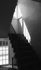 Of Light And Shadow (Burnt Umber) Tags: scala 200 35mm film bw rpilla001 south fujica ax3 tamronspadaptall23580mm architecture building stair steps fireescape railing metal shade shadow