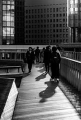 Reflected light (tokyobogue) Tags: tokyo japan marunouchi tokyostation nikon nikond7100 d7100 goldenhour dusk tokina tokina100mmf28atxprod blackandwhite blackwhite monochrome people