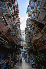 Quarry Bay, Hong Kong (mikemikecat) Tags: quarry bay hong kong architecture one person man only city built structure building exterior residential district day incidental people way forward nature sky outdoors low angle view street walking direction transportation lifestyles diminishing perspective apartment alley mikemikecat happyplanet asiafavorites