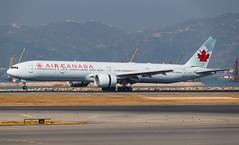 AIR CANADA B777-300ER C-FIVQ 001 (A.S. Kevin N.V.M.M. Chung) Tags: aviation aircraft aeroplane airport airlines apron plane spotting airside ramp hkg boeing b777 b777300er worldliner