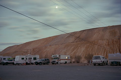 (patrickjoust) Tags: fujica gw690 kodak portra 160 6x9 medium format 120 rangefinder 90mm f35 fujinon lens c41 color negative film cable release tripod manual focus analog mechanical patrick joust patrickjoust west western us usa united states north america estados unidos rural small town ruth nevada nv mining desert camper truck vehicle auto automobile parked moon clouds dusk after dark mine tailing debris lot wire wires