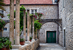 Franciscan Monastery, Hvar (Jocelyn777 - Celebrating Europe) Tags: architecture buildings stone stonebuildings monuments courtyard facades doorsandwindows plants flowers foliage starigrad oldtown hvar croatia travel