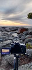 Getting shots (felix200SX) Tags: sunset sea skyline sky clouds rocks camera tripod