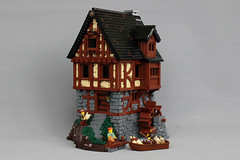 Holt Watermill (-soccerkid6) Tags: lego moc creation model design technique roof shingle wall stone wood tudor timber landscape irregular base rowboat watermill building medieval castle historica house home window stairs furniture interior dock ccc