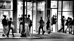 Gallery-to-Gallery (Bob_Wall) Tags: bobwall btwgf blackandwhite monochrome night street urban sanjose people galleries gallery store storefront motion action