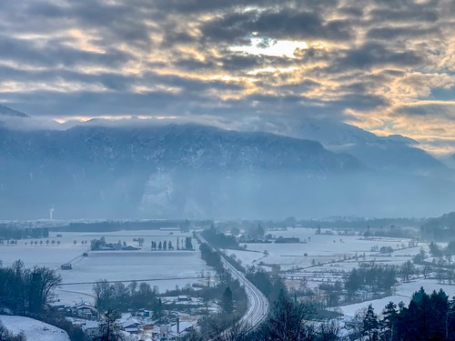 Winter view of river Inn valley and Kaiser mountains from Schloßberg in Oberaudorf, Bavaria, Germany