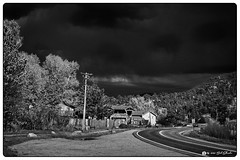Storm Approaching (Bob Shrader) Tags: olympusmzuikodigital25mmf12pro 25mm f71 1500sec 200iso raw microfourthirds mft m43 mirrorless northamerica unitedstatesofamerica america us unitedstates usa colorado estespark highway us34 sign sidewalk walkway plant trees sky clouds olympusem5markii omdem5markii primelens wideshot exterior outdoors on1 photoraw2020 presets bwmodern b16 blackandwhite bw blackwhite monochrome monotone highcontrast style lowkey photoborder photoedge photoframe postprocessing preset