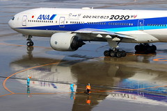 Reflection with 全日空... (Manuel Negrerie) Tags: 全日空 moment photography hnd 777200 ana ja745a airport people aviation livery spotting canon avgeels aircraft planes jetliner japan instants engines technology airliner nh hanedaairport tokyo2020 2020