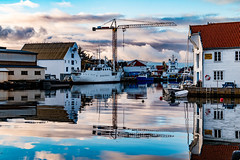 Nothing was moving (langdon10) Tags: harbour karmøy northsea norway skudeneshavn water boats buildings calm clouds crane fishingvillage quiet reflections ship shoreline