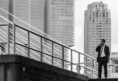 Call me (michael_hamburg69) Tags: rotterdam niederlande netherlands südholland holland southholland man guy suit telephone waiting bridge brücke erasmusbrug erasmusbrücke schrägseilbrücke nieuwemaas rheinmaasdelta erasmus strasenbrücke dezwaan vanberkelbos 1996 cablestayedandbasculebridge steel stahl nl derotterdam wilhelminapier monochrome male