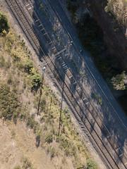 Railway cutting (Paul Threlfall) Tags: djimavicproplatinum drone flight traintracks bike rider path diagonal shadows bicycle aerial