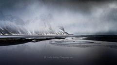Vestrahorn, receding tide, approaching storm (pixellesley) Tags: vestrahorn iceland beach storm blacksand winter cold icy sand mountains ocean reflections