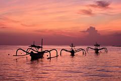 Nusa Dua Sunrise (WayneG58) Tags: nusadua seascape outriggers boats reflections water ocean pastels pink sunrise indonesia bali