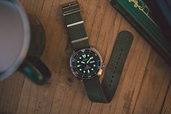 Seiko Turtle (Robbie Khan) Tags: watch watches seiko turtle srp777 wristwatch 35mm canon lume rsm strap nato herringbone moody dim lowlight low light ambience ambient green