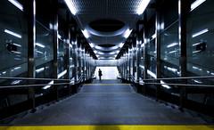 Deeper Underground (CoolMcFlash) Tags: subway station symmetry person street streetphotography futuristic architecture canon eos 60d vienna ubahn symmetrie futuristisch modern architektur wien fotografie photography stairs stufen treppen sigma 1020mm 35