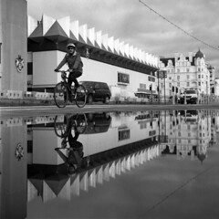 Speed Twin (4foot2) Tags: streetphoto streetshot street streetphotography candid candidportrate pushbike bike puddle water reflection brighton seafront seaside promenade peoplewatching people peopleofbrighton interestingpeople speed fast reportage reportagephotography analogue film filmphotography 120film mediumformat blackandwhite bw mono monochrome hp5plus ilfordhp5plus ilford kodakhc110 hc110 kodak twinlensreflex tlr rolleiflex rolleiflex35c rollei fourfoottwo 4foot2 4foot2flickr 4foot2photostream explore113