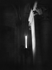 Light in the dark (Missing Pictures) Tags: hungary pannonhalmi monochrome light dark mystery enigma abbey monastery candle black bw blackandwhite white travel traveling explore exploring eu europe mood magic magiclight atmosphere architecture interior