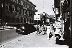 Roma (goodfella2459) Tags: nikonf4 afnikkor24mmf28dlens cinestillbwxx 35mm blackandwhite film analog city streets pedestrians road car buildings people roma italy rome bwfp
