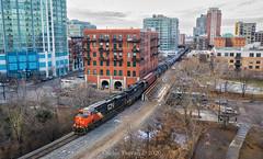Chicago Core (Carlos Ferran) Tags: cn canadian national train trains local l536 chicago urban city downtown core skyscraper condo railroads locomotive ge illinois central ic