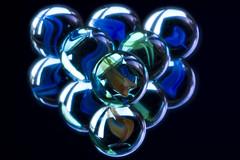 Marble-ous Triangle (steve_whitmarsh) Tags: macro closeup ball marble art colour blue orange green black blackbackground macromondays triangle