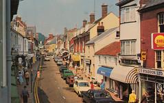 High Street, Budleigh Salterton old postcardmid-late 1970s (Spottedlaurel) Tags: budleighsalterton oldpostcard 1970s ctstaddon staddons garage gilbern