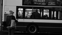 Don't Cross Yet (byronv2) Tags: edinburgh edimbourg scotland blackandwhite blackwhite bw monochrome peoplewatching candid street newtown princesstreet pedestriancrossing bus publictransport pedestrain crossing woman dusk